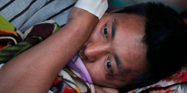 A Nepalese victim of an earthquake rests at Teaching Hospital in Kathmandu, Nepal, Tuesday, May 12, 2015....