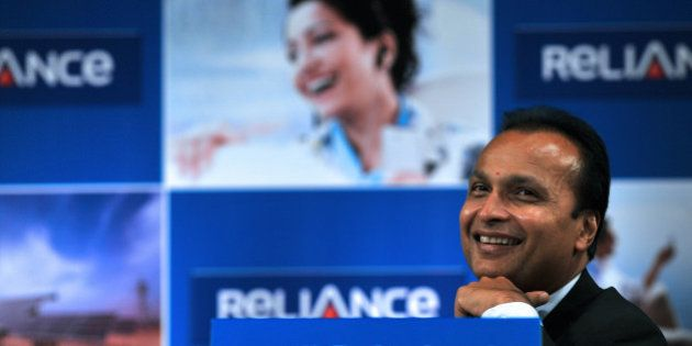 Indian industrialist and Chairman of ADAG (Anil Dhirubhai Ambani Group) Anil Ambani smiles during the...
