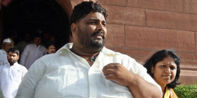 Member of Parliament from India's Rashtriya Janata Dal (RJD) Pappu Yadav (L), who is serving a life sentence...