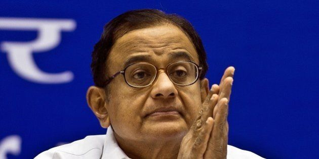 Indian Finance Minister P. Chidambaram listens to the speech given by Prime Minister Manmohan Singh during...