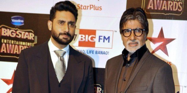 Indian Bollywood film actors Abhishek Bachchan (L) and Amitabh Bachchan attend the 'BIG Star Entertainment...