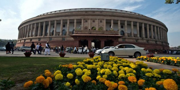 Indian parliamentarians leave after the Rajya Sabha (Uppar House) adjourned at Parliament house during...