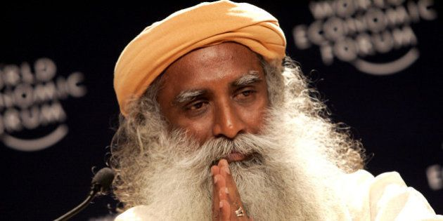 Founder of the Isha Foundation, India, Sadhguru Jaggi Vasudev gestures while speaking during a closing...