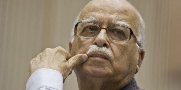 Bhartiya Janta Party (BJP) President L.K. Advani listens to Indian Prime Minister Manmohan Singh's speech...