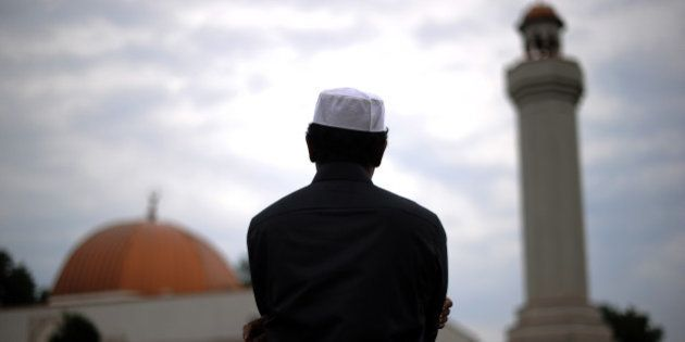 A Muslim takes part in a special morning prayer to start Eid-al-Fitr festival, marking the end of their...