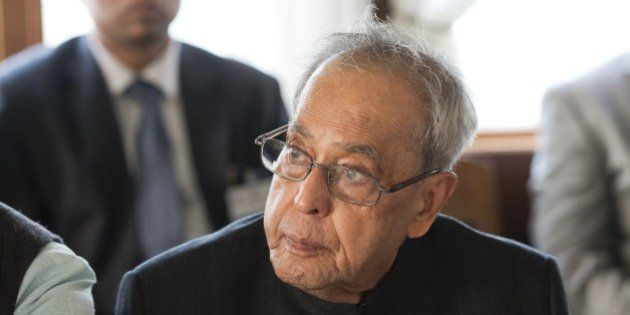 President of India Shri Pranab Mukherjee listens during a boat trip to Hammarby Sjoestad and roundtable...