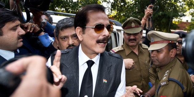 India's Sahara group chairman Subrata Roy (C) speaks to the media as he arrives at the Supreme Court...