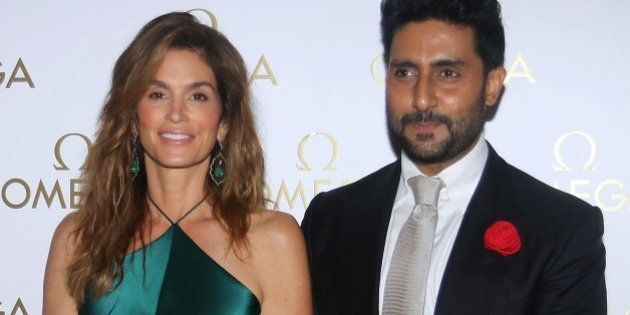 US model Cindy Crawford and Indian Bollywood actor Abhishek Bachchan pose as they arrive to attend a...