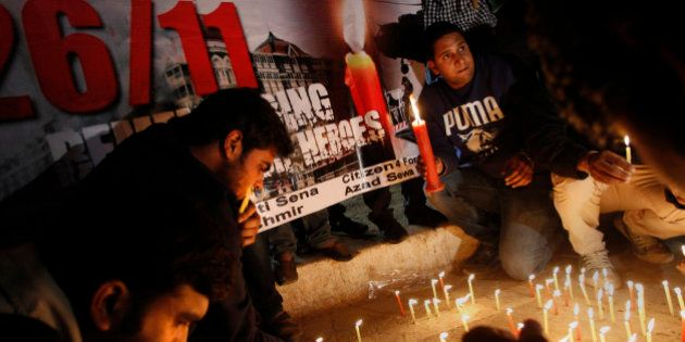 Indians participate in a candle light vigil in memory of those who lost their lives in the 2008 Mumbai...