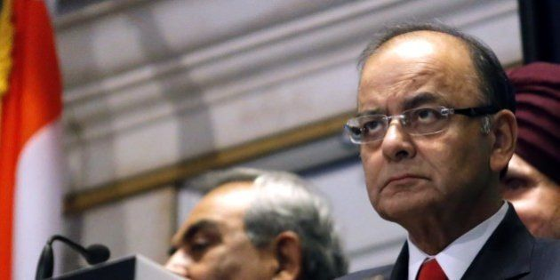 India's Finance Minister Arun Jaitley looks on before he rings the closing bell for the trading session...