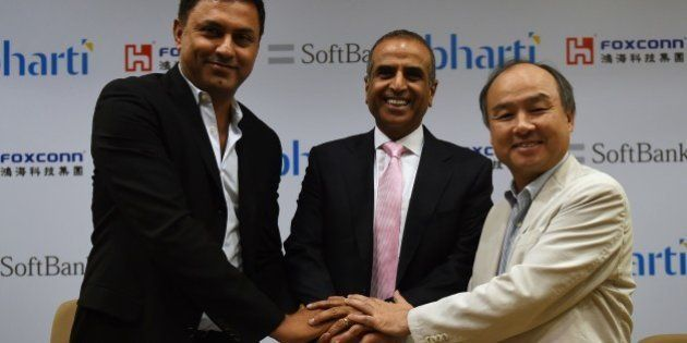 Chairman of Bharti Enterprises Sunil Bharti Mittal (C), CEO of SoftBank Masayoshi Son (R) and Chairman...
