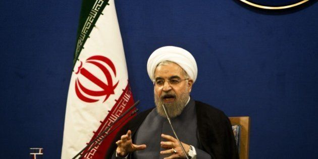 Iranian President Hassan Rouhani speaks during a press conference in Tehran on June 13, 2015. There are...