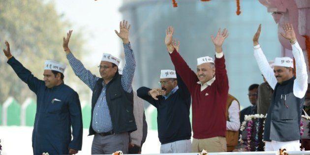 Aam Aadmi Party (AAP) president Arvind Kejriwal (C) and fellow AAP ministers Asim Ahmed Khan (L), Satyendra...