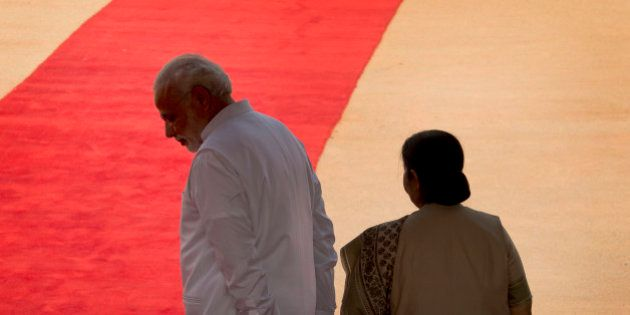 Indian Prime Minister Narendra Modi, left, and Foreign Minister Sushma Swaraj wait for the arrival of...