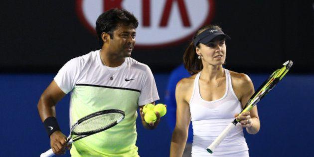 MELBOURNE, AUSTRALIA - FEBRUARY 01: Martina Hingis of Switzerland and Leander Paes of India celebrate...