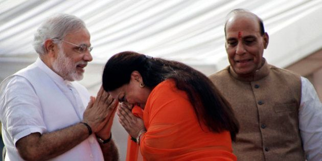 India's main opposition Bharatiya Janata Party (BJP) leader Vasundhara Raje, center, greets party prime...