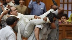 PHOTOS: The Dramatic Moment A BJP Leader Had To Be Carried Out, Kicking And Screaming, Of Delhi