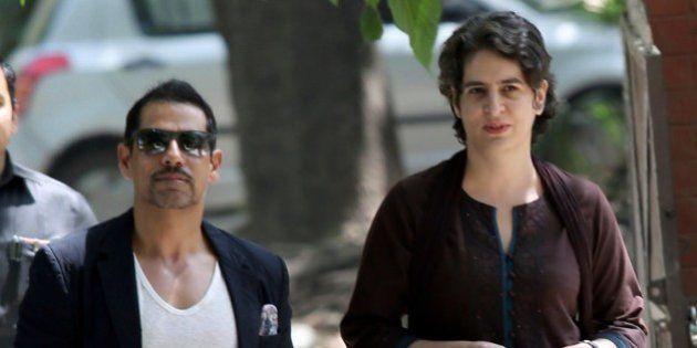 Priyanka Gandhi (R), daughter of India's Congress Party president Sonia Gandhi, and her husband Robert...