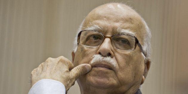 Bhartiya Janta Party (BJP) President L.K. Advani listens to Indian Prime Minister Manmohan Singh's speech during the Indian National Integration Council meeting in New Delhi on September 23, 2013. Measures to prevent communal disturbances and to tackle them will be discussed at the National Integration Council meeting, convened against the backdrop of Muzaffarnagar riots in Uttar Pradesh that has claimed 48 lives. AFP PHOTO/ Prakash SINGH        (Photo credit should read PRAKASH SINGH/AFP/Getty Images)