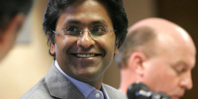 Chairman of the Indian Premier League Lalit Modi smiles at a news conference in Johannesburg, Tuesday,...