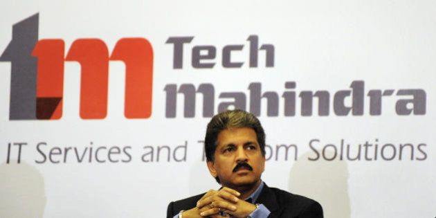 Chairman of Tech Mahindra, Anand Mahindra listens to a question during a press conference in Hyderabad...