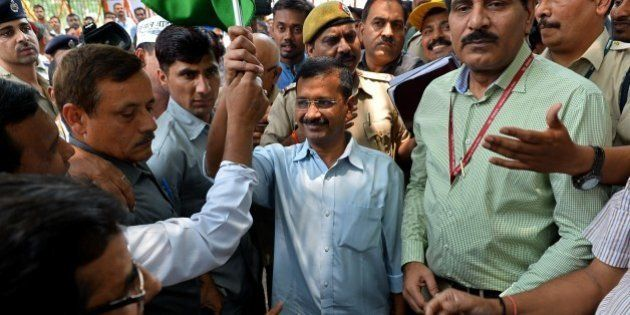 Chief Minister of Delhi Arvind Kejriwal (C) flags off mechanical road cleaning and sweeping trucks in...