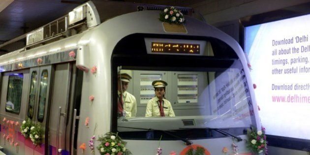 A decorated Delhi Metro train is pictured at the Mandi House station platform during a flagging-off ceremony...