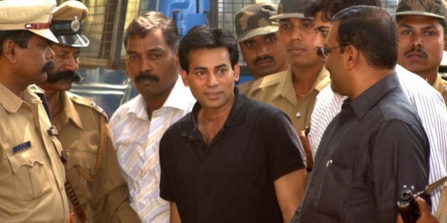 Police personnel surround Abu Salem, center, as he is taken to a forensic science laboratory in Bangalore,...