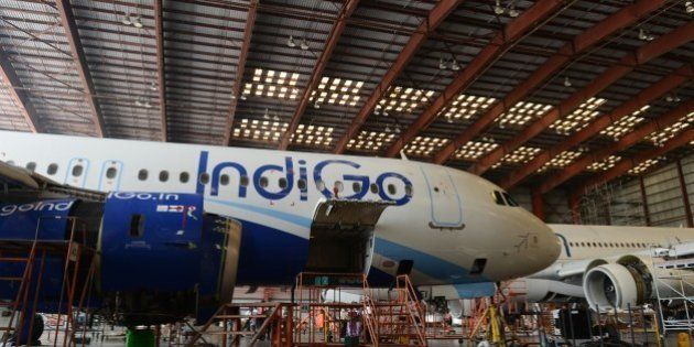 In this photograph taken on November 10, 2014 an aircraft of the Indian budget carrier IndiGo undergoes...