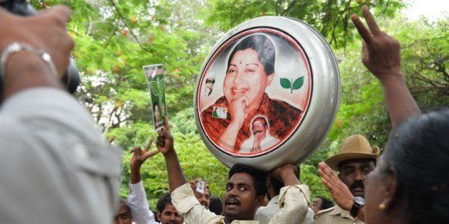 Supporters of All India Anna Dravida Munnetra Kazhagam (AIADMK) supremo, Jayalalithaa Jayaram dance and...