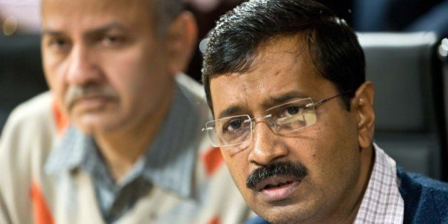Delhi Chief Minister ,Arvind Kejriwal (R) delivers a statement as Minister for Education, PWD and Urban...