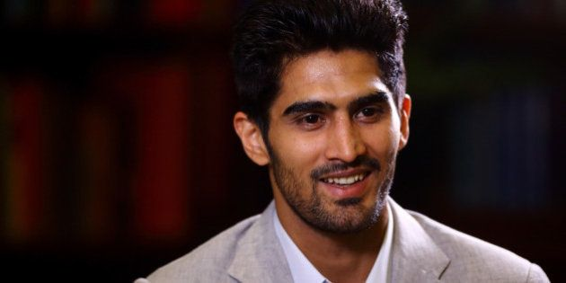 LONDON, ENGLAND - JUNE 29: Vijender Singh gives a TV interview during a Press Conference at the Cinnamon...