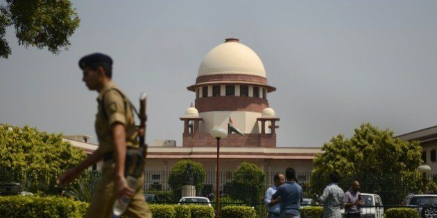 A security personel walks in front of the Indian Supreme court in New Delhi on August 27, 2014. India's...
