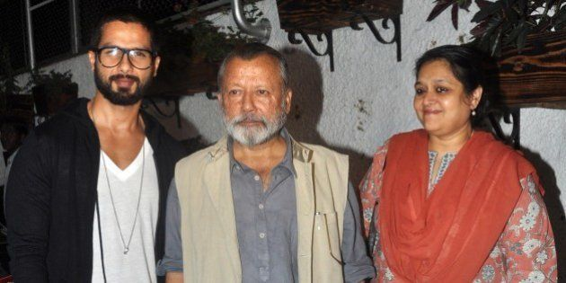 Indian Bollywood actor Shahid Kapoor (L) and his father, actor and director Pankaj Kapoor (C) and his...