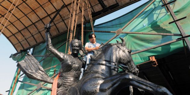 Indian craftswoman Jasuben Shilpi, known as the Bronze Woman of India, gives finishing touches to a life-size...