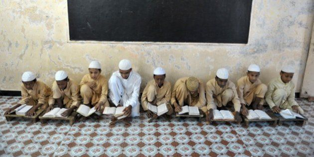 Indian Muslim students recite from the Quran in a classroom during the month of Ramadan at The Madrasa...