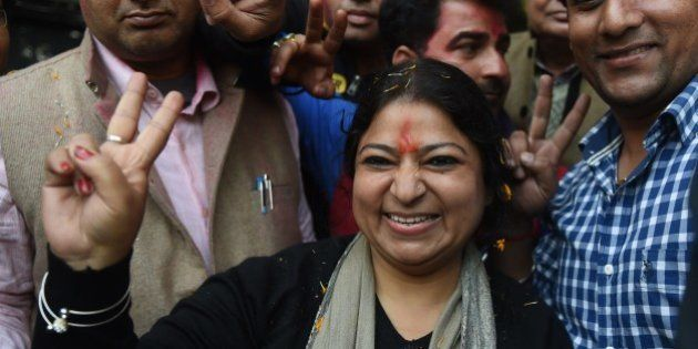 Senior Leader of India's Aam Aadmi Party (AAP) Bhavna Gaur (C) poses with supporters as she arrives for...
