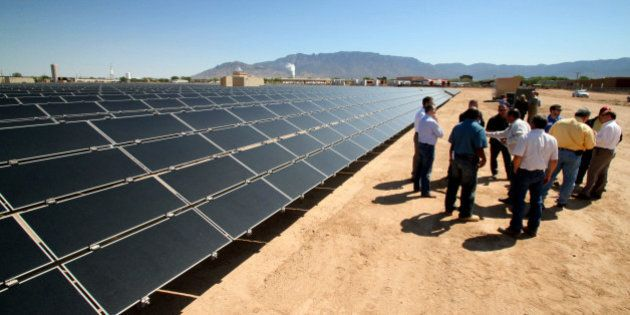 FILE - This April 20, 2011 file photo officials with Arizona-based First Solar and Public Service Company...