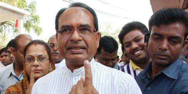 Chief Minister of the central Indian state of Madhya Pradesh Shivraj Singh Chouhan (C) poses with his...