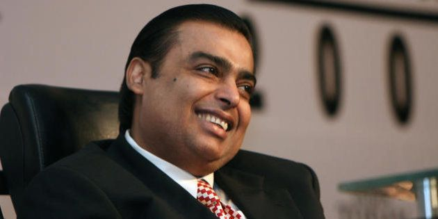 Chairman and Managing Director of India's Reliance Industries Ltd, Mukhesh Ambani smiles as he attends...