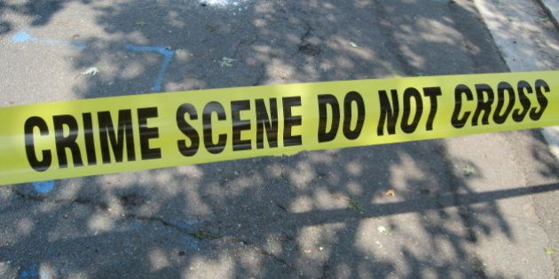 Crime scene tape put up on our street to block