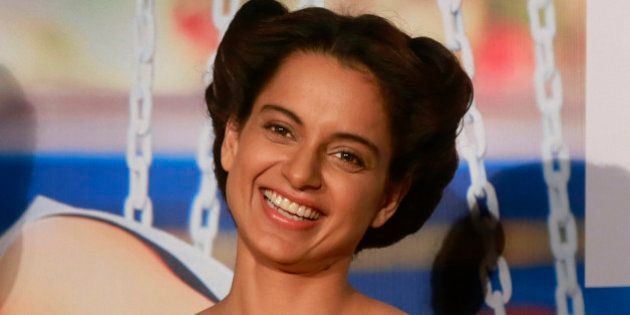 Indian Bollywood actress Kangana Ranaut smiles as she listens to a question from a journalist during...