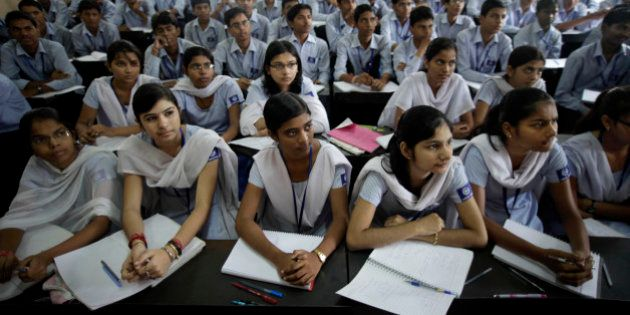 In this Thursday, Aug. 5, 2010 photograph, students attend a class at a cram school in Kota, India. Every...