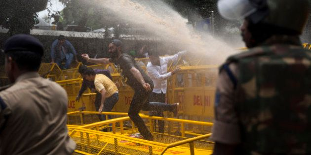Police use water canon to disperse activists of India's Congress party's youth wing as they protest against...