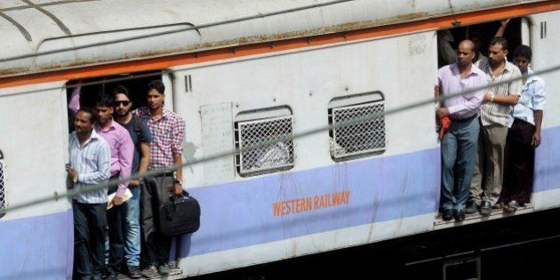 TO GO WITH INDIA-ECONOMY-TRANSPORT-RAIL-BUDGETIn this photograph taken on June 30, 2014, Indian passengers...