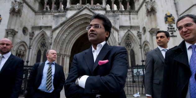 Ex-chairman of India's cricket IPL, Lalit Modi (C), leaves the High Court in central London on March...