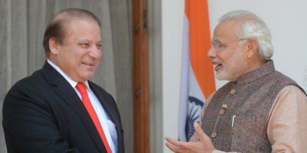 India's newly sworn-in Prime Minister Narendra Modi (R) talks with Pakistani Prime Minister Nawaz Sharif...