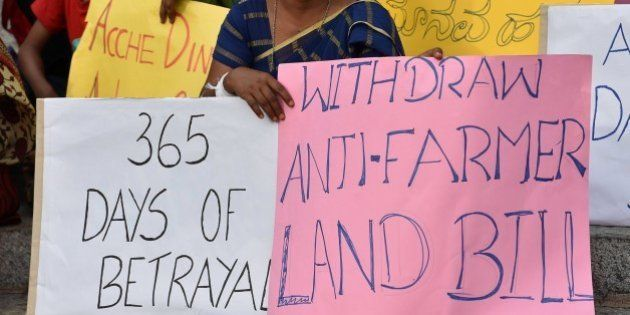 Activists stage a protest against Prime Minister Narendra Modi's government in Bangalore on June 6, 2015....
