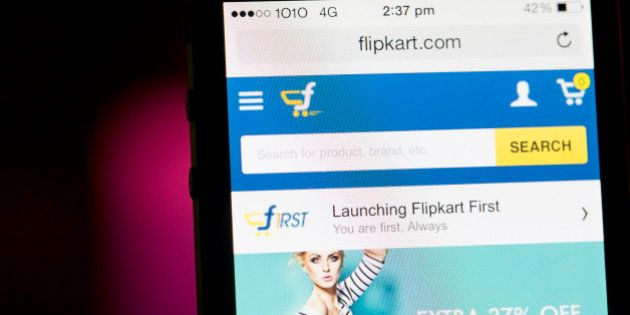 Flipkart's application is displayed on an Apple Inc. iPhone 5c in an arranged photograph in Hong Kong,...