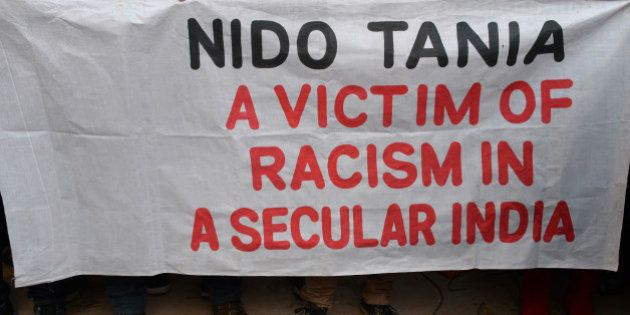 Indian students from the northeastern states and supporters hold a banner as they protest the death of...